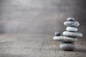 Co-parenting: a tower of stones perfectly balanced in alignment
