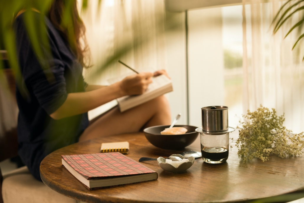 Stepmom self-worth: processes her emotions by journalling with a coffee
