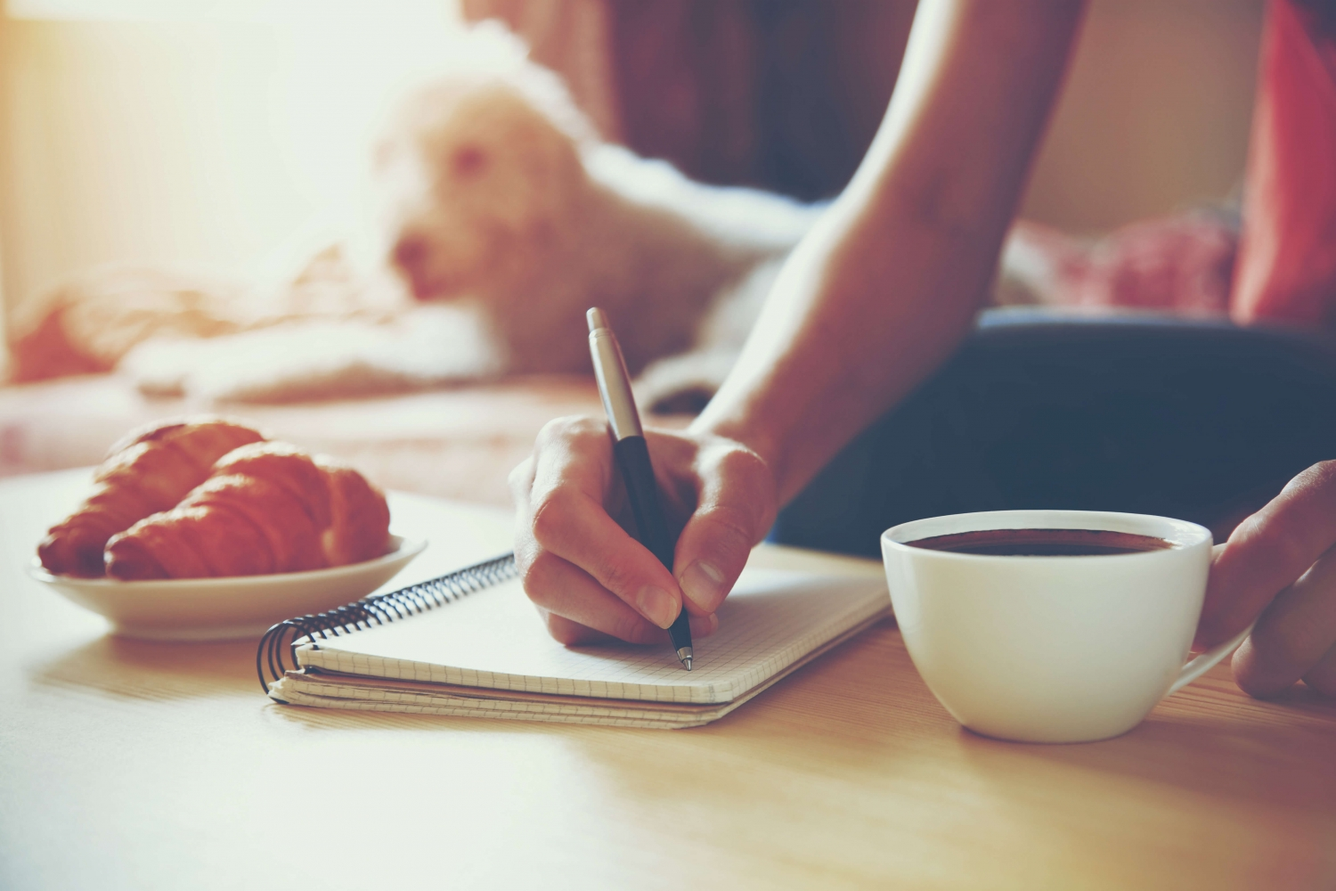 Stepmom self-love relaxing with a coffee and capturing her emotions and experiences in her journal