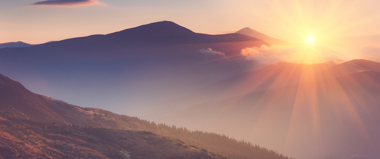 Freedom from the Chaos co-parenting: the sun rises over the mountains