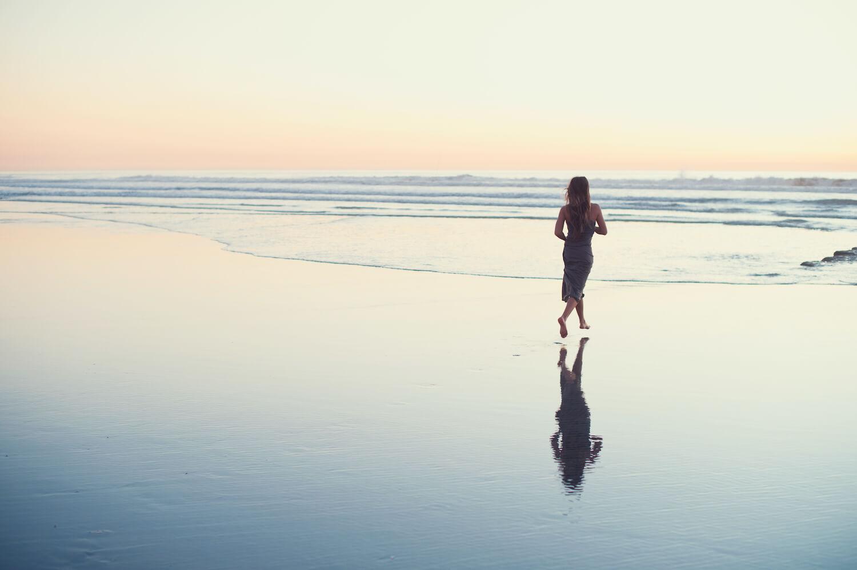 Maiko Michelle running along the shore